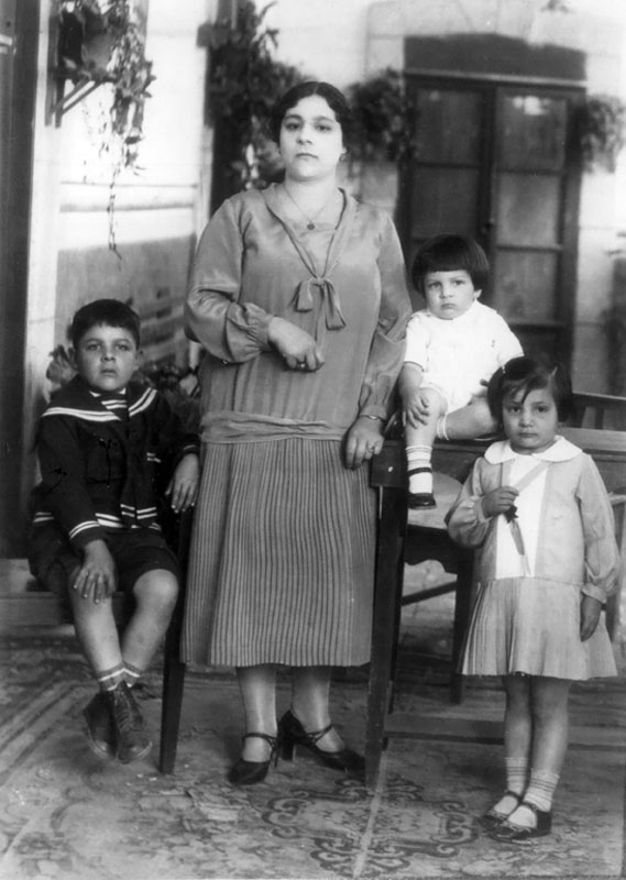 Doña Carmelita and 3 of her children: José Alfredo (white shirt), Conchita & Ignacio (1931).